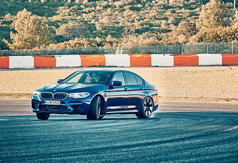 BMW M5 in drift mode on track: photographed for CAR magazine