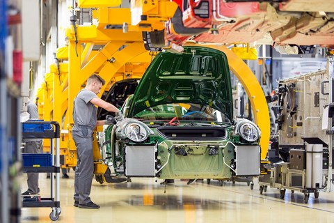 A Porsche 911 is finished at the Stuttgart factory. One in eight Porsches is still a 911