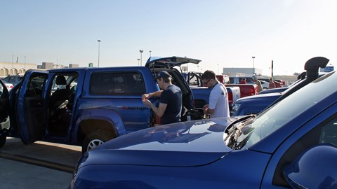 The whole range of V6 Amaroks lined up in the Muscat airport car park ahead of the trip