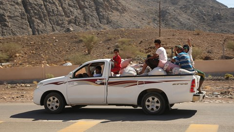 Local Omani Toyota Hilux loaded with goods - and people
