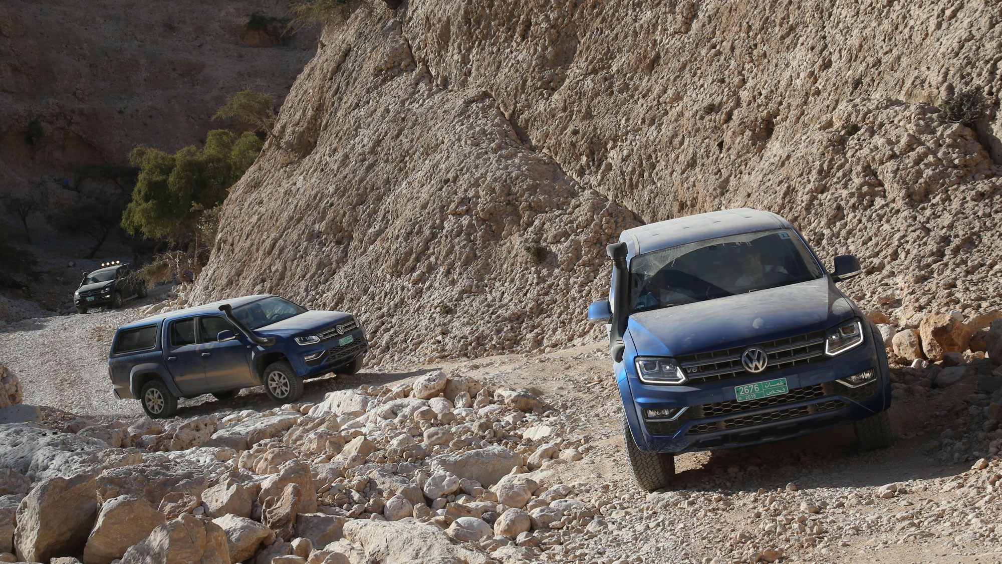 Convoy Of Dusty Vw Amaroks In The Omani Mountains