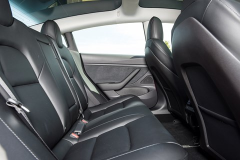 Tesla Model 3 rear seats: cleverly scalloped out front pews liberate more space for feet