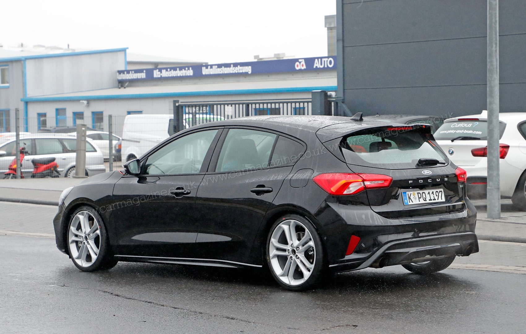 Rear valance and subtle spoiler visible at rear of ford focus st hot hatch