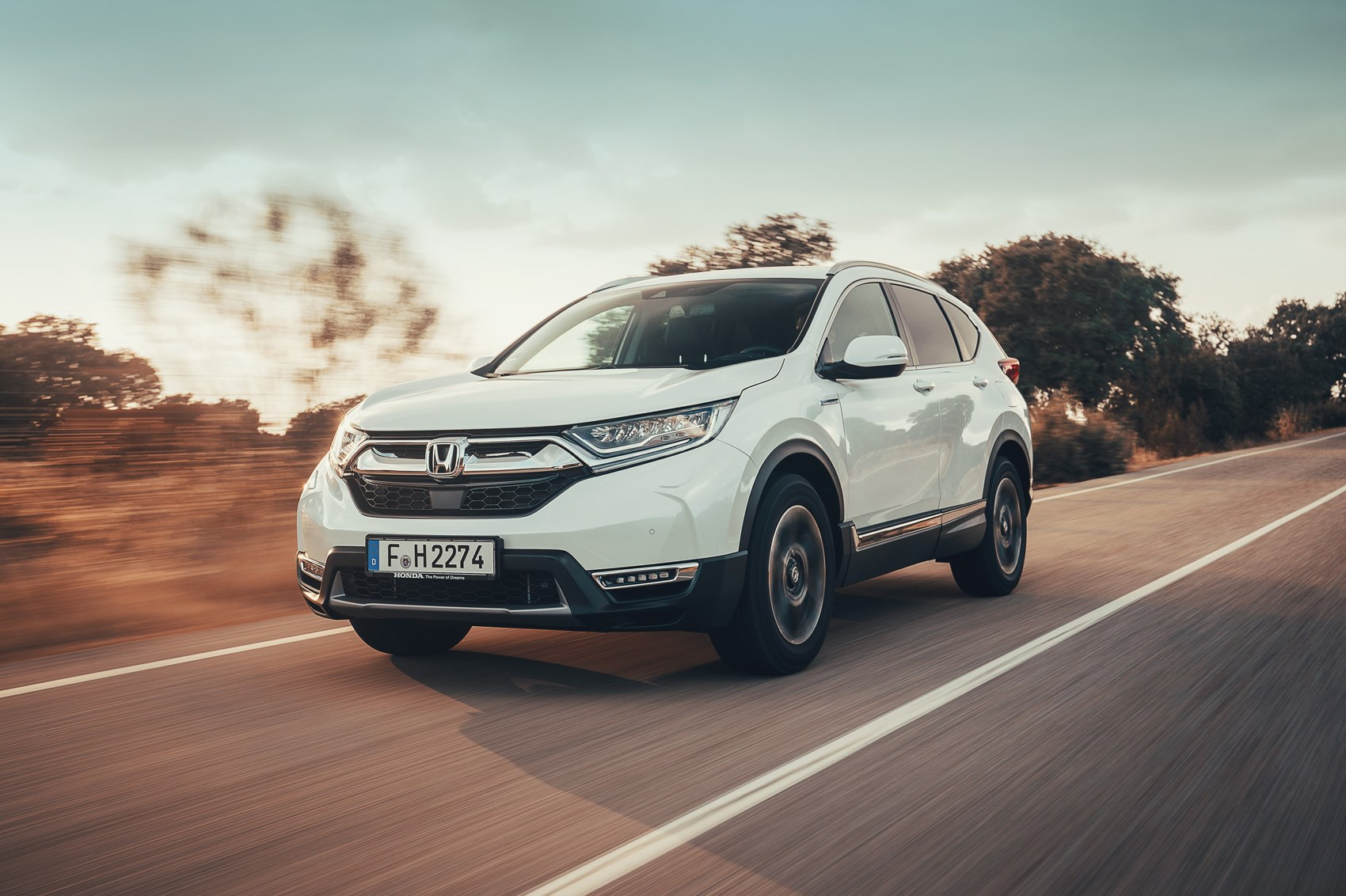 Honda CR-V Hybrid white driving