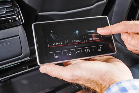Rechargeable tablet sits in Audi A8 L rear armrest, controls many minor functions