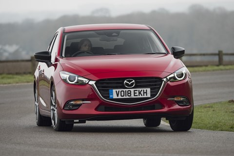 The outgoing 2018 Mazda 3 hatchback in the UK