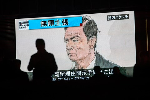 An artist's impression of Carlos Ghosn in court in Tokyo flashes up on Japanese TV (Getty)