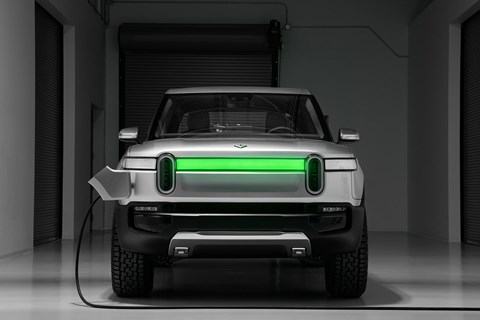 Charge up the Rivian R1T and the light bar goes green when charging