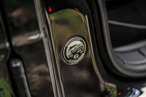 Schockl proved sign on the Mercedes G-Wagen's B-pillar