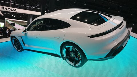 Porsche Taycan at the Frankfurt motor show 2019 - rear side view on blue plinth