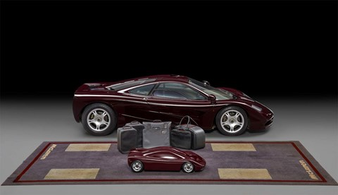 Rowan Atkinson's McLaren F1 comes with its own luggage set, a model and a £1600 mat he saw on a visit to the factory