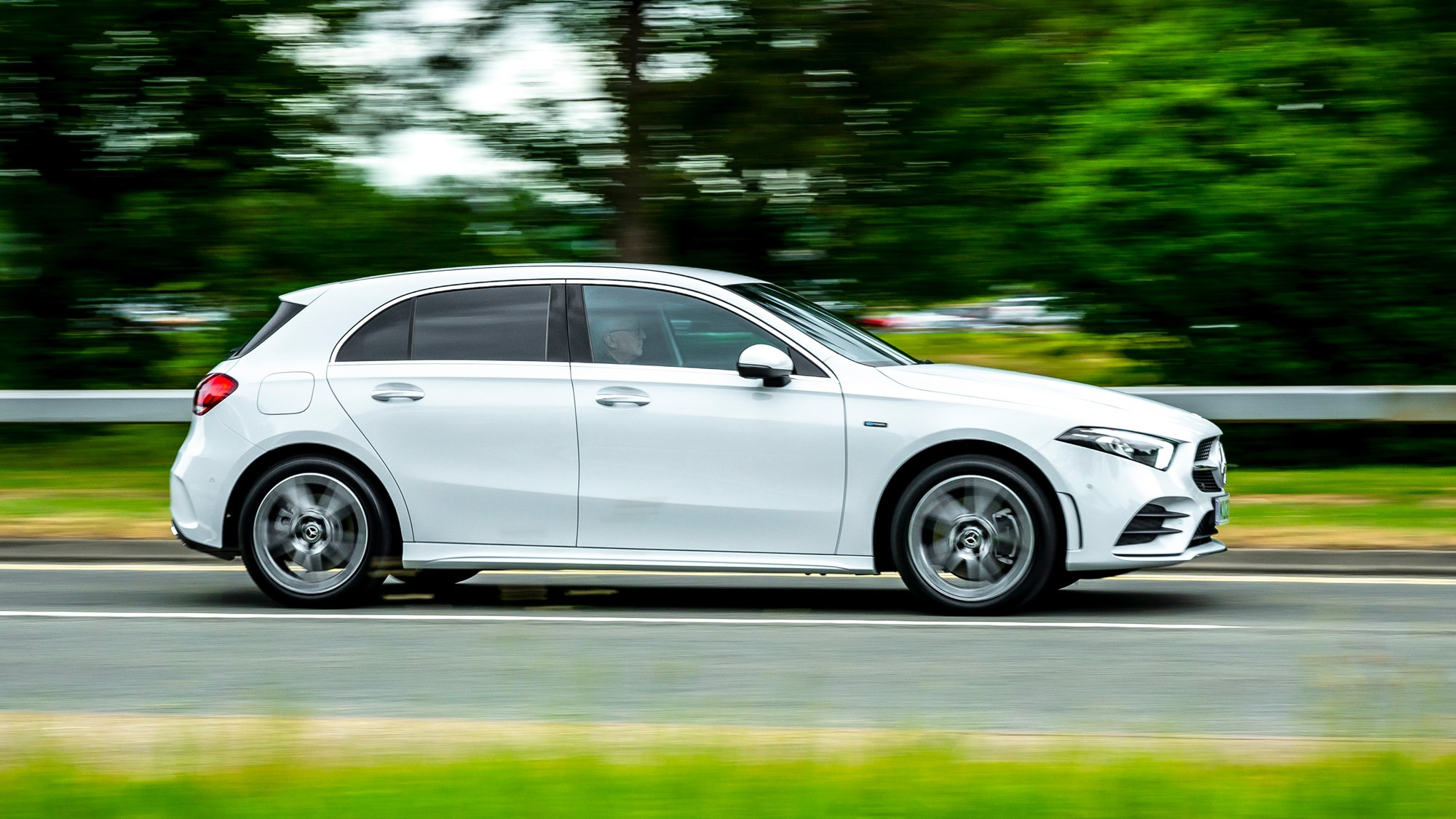 Mercedes-Benz A250e plug-in hybrid review, 2020, white, side view, driving
