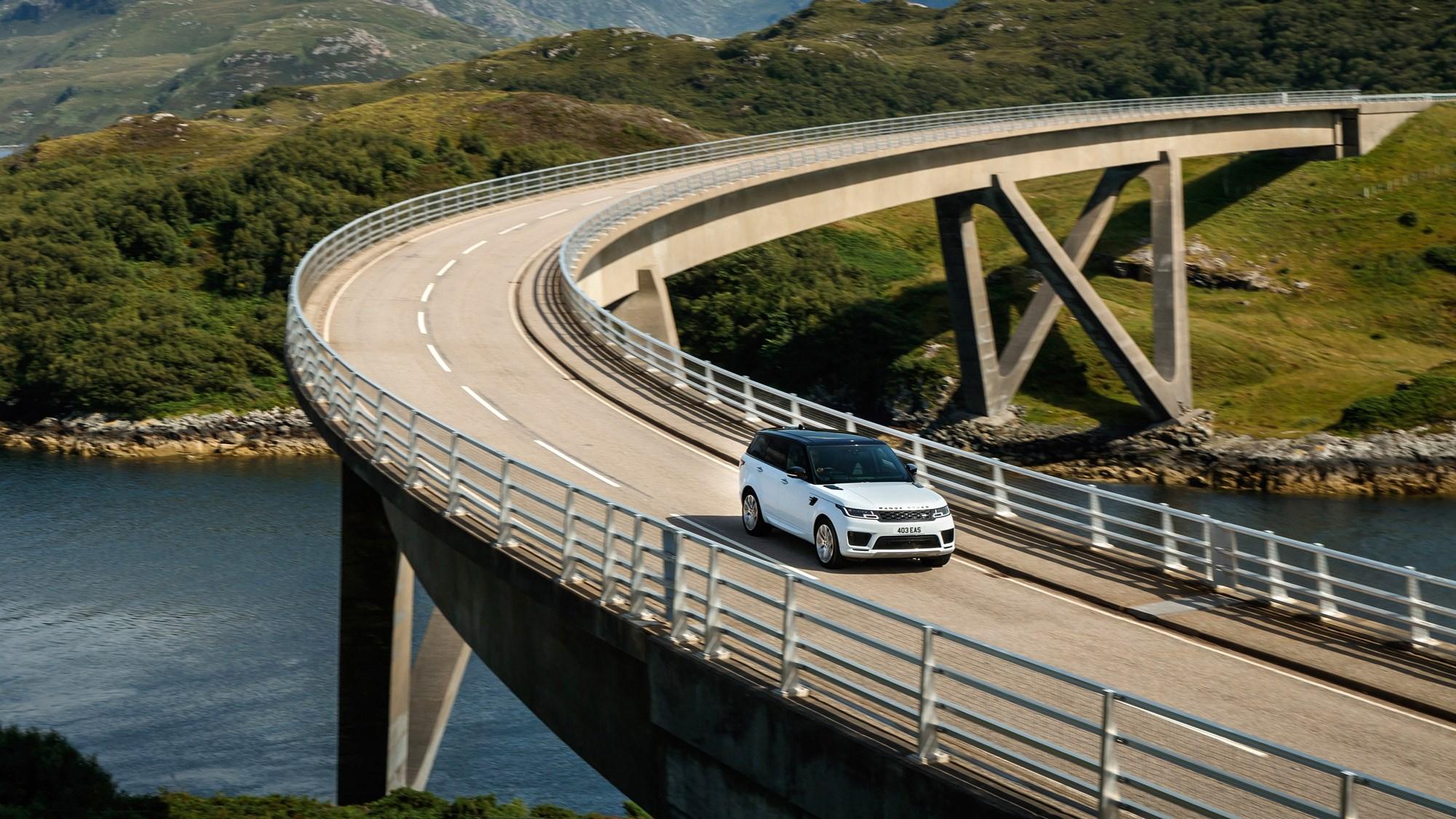 White Land Rover Range Rover Sport D350 driving on Kylesku Bridge