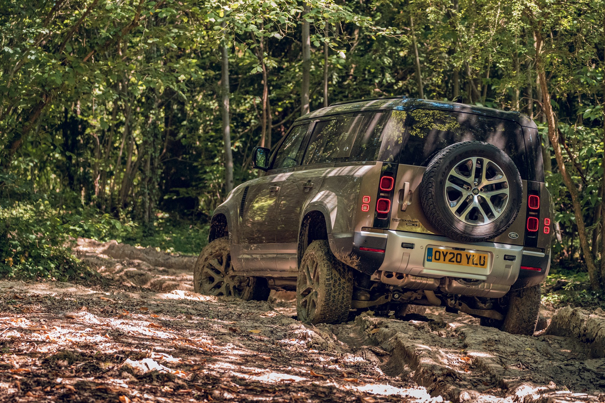 Land Rover Defender (2020) off-road view from rear, driving