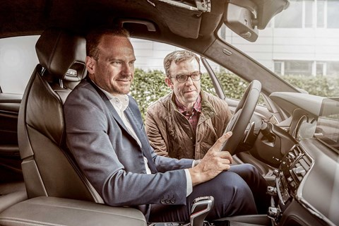 Markus Flasch (left), new boss of BMW M, shows Tim Pollard (right) round the M5