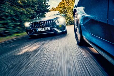 Merc A45 chases the BMW M135i in CAR magazine's twin test