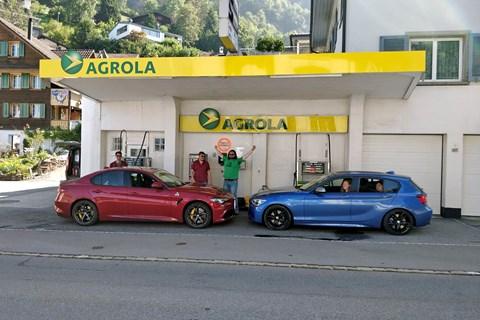 Alfa Romeo Giulia, BMW M135i filling up in Lucerne