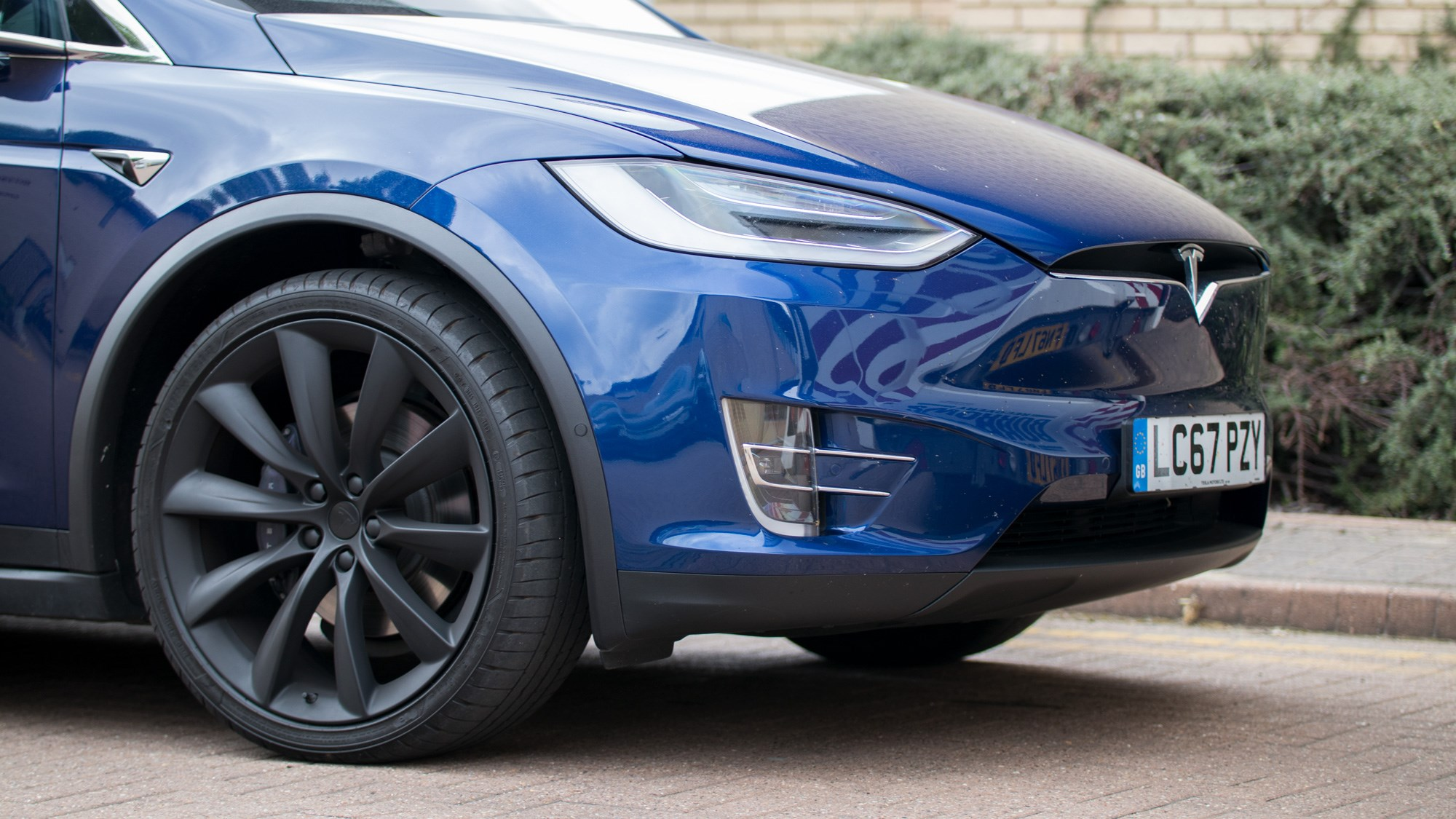Tesla Model X - front wheel and grille-less face