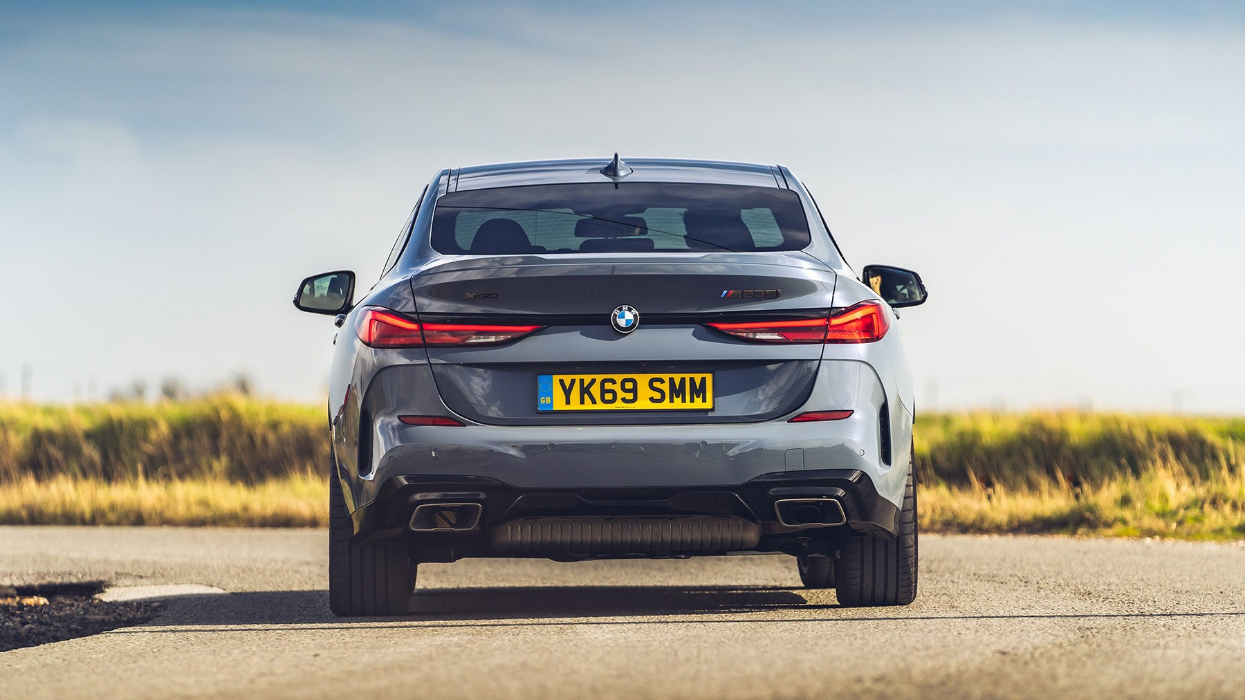 BMW M235i driving, rear, 2020