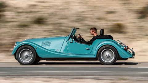 Turquoise 2020 Morgan Plus Four side elevation driving