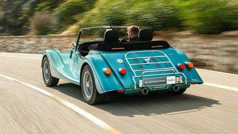 Turquoise 2020 Morgan Plus Four rear three-quarter driving