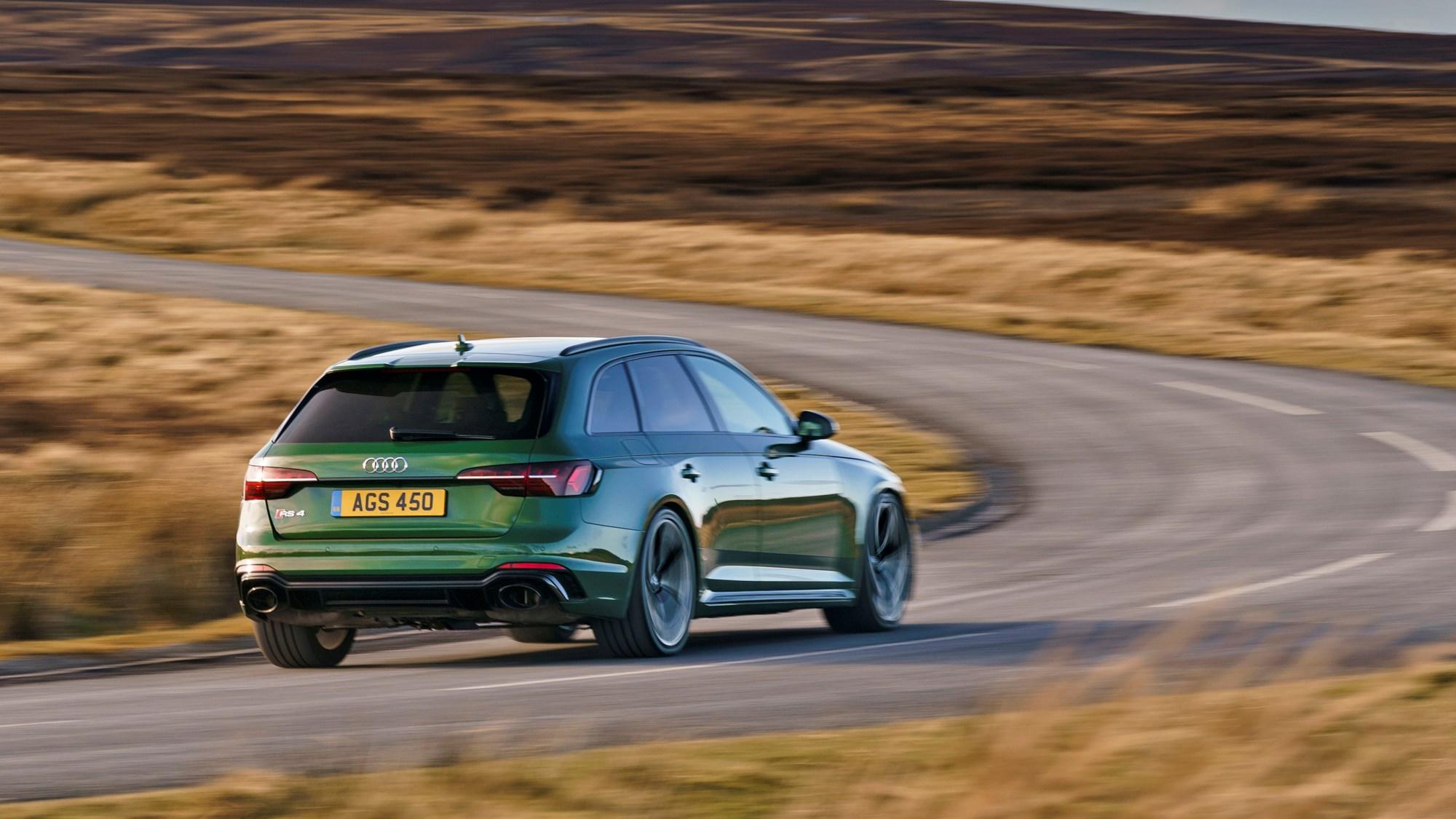 Green 2021 Audi RS4 Avant rear three-quarter driving