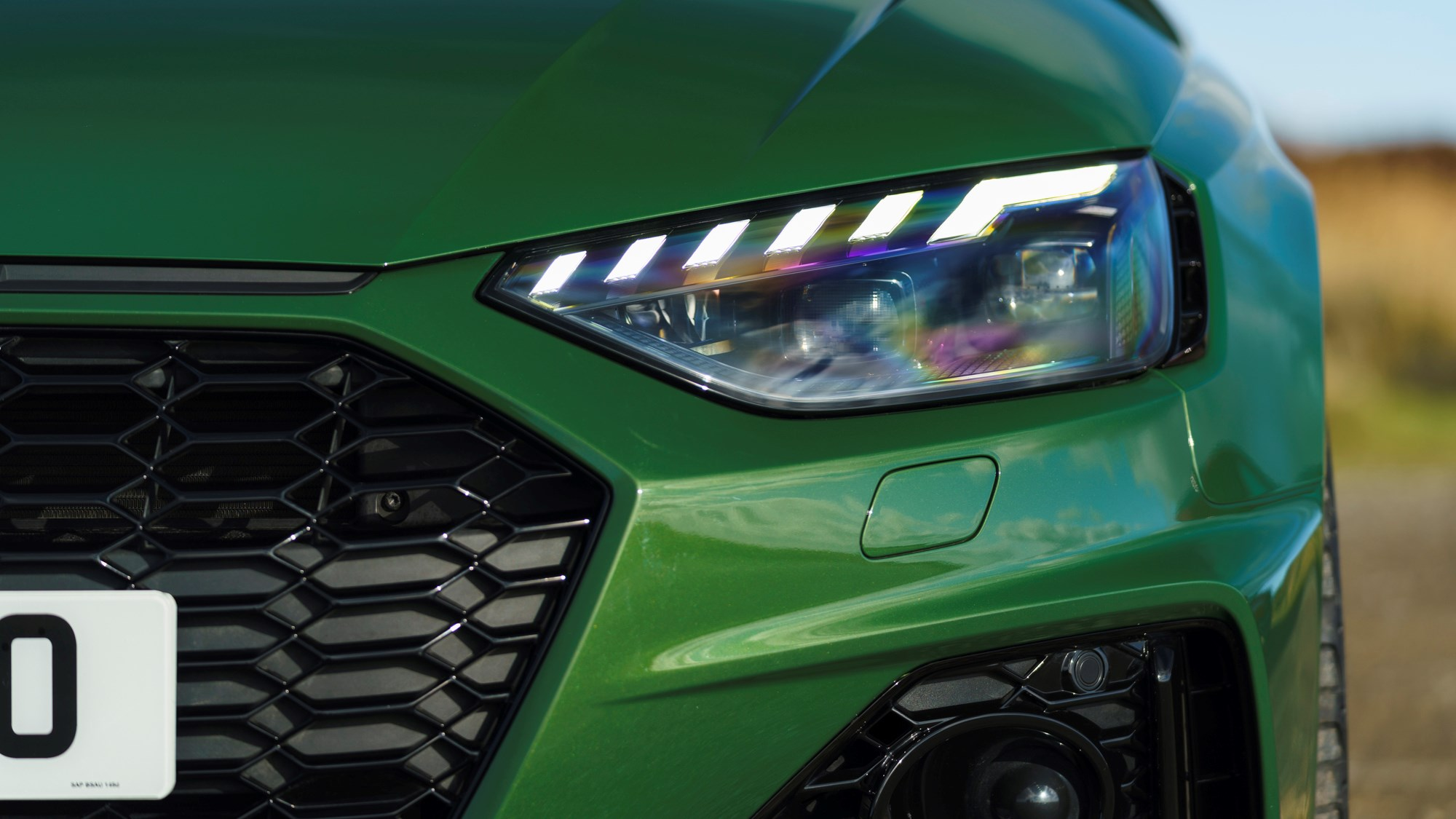 Green 2021 Audi RS4 Avant headlamp and grille detail