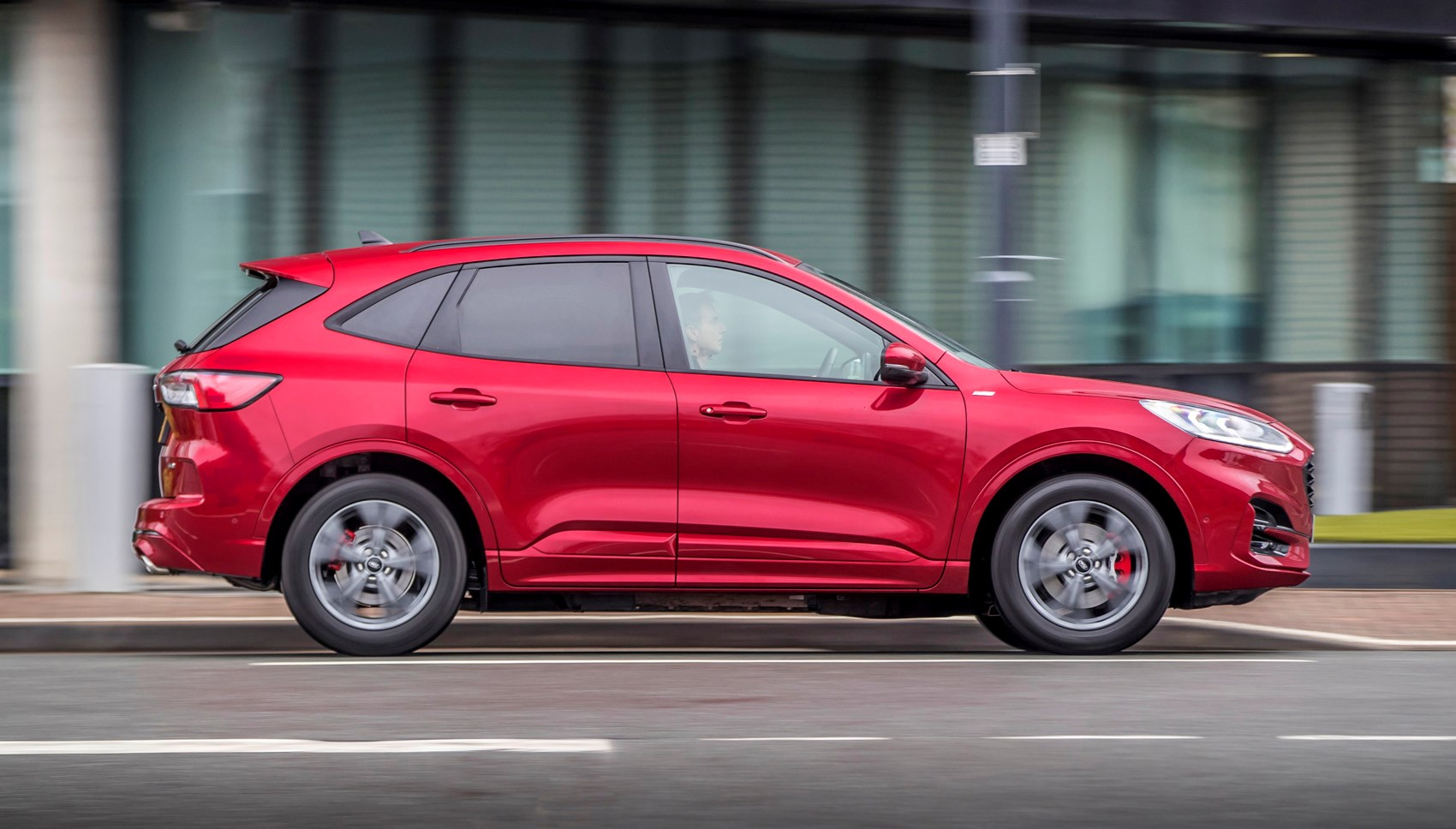 Lucid Red 2020 Ford Kuga ST-Line First Edition PHEV side elevation driving