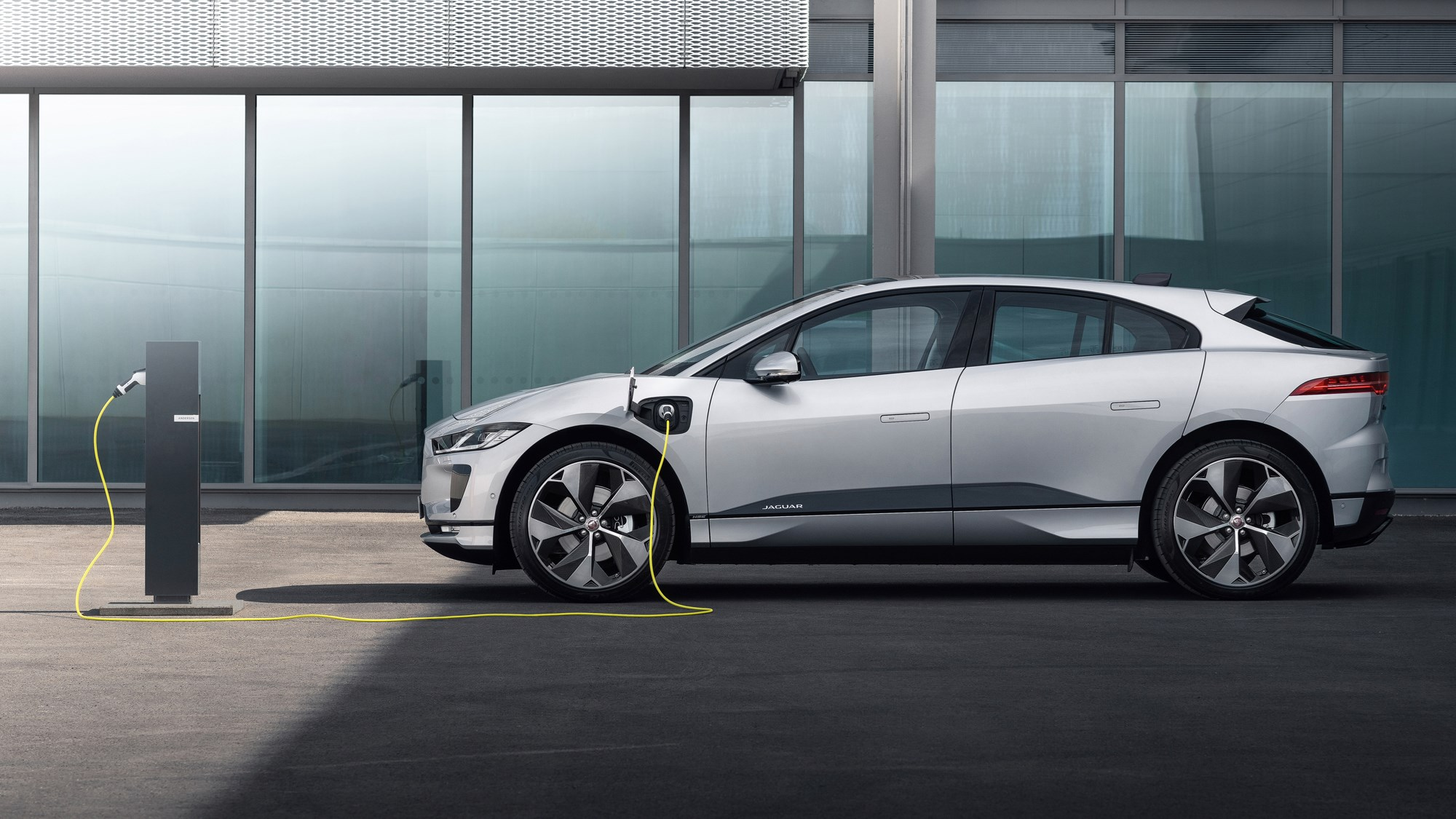 Silver 2020 Jaguar i-Pace side elevation on charge