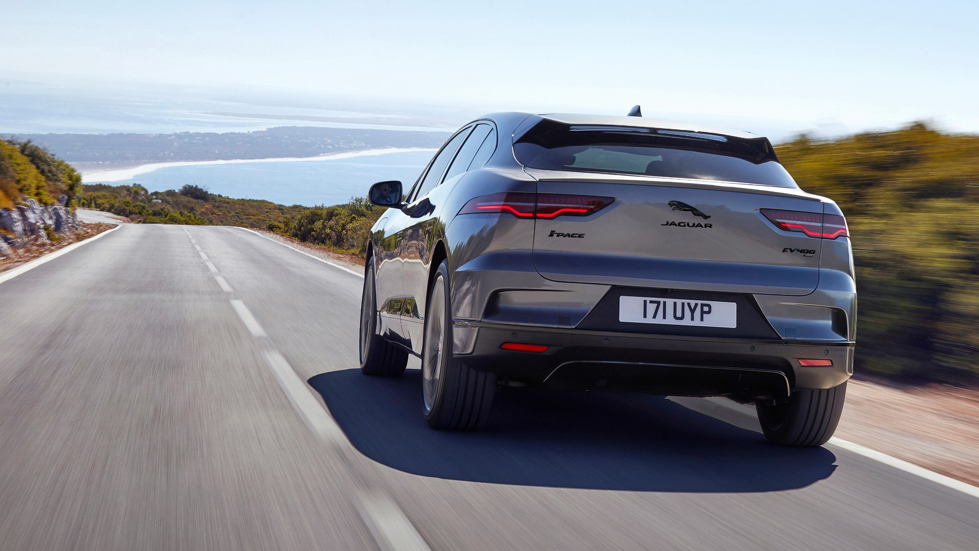 Grey 2020 Jaguar i-Pace rear three-quarter driving