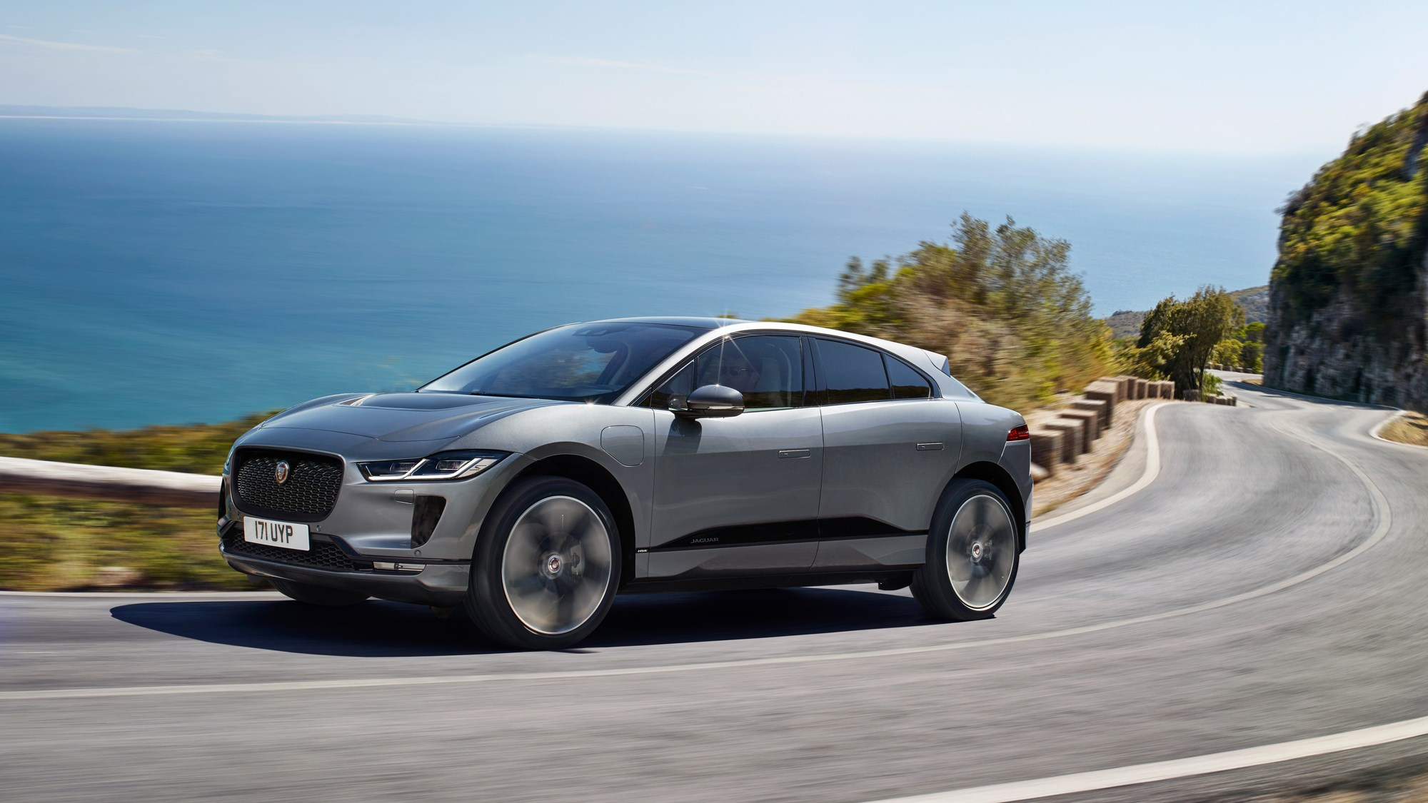 Grey 2020 Jaguar i-Pace front three-quarter driving