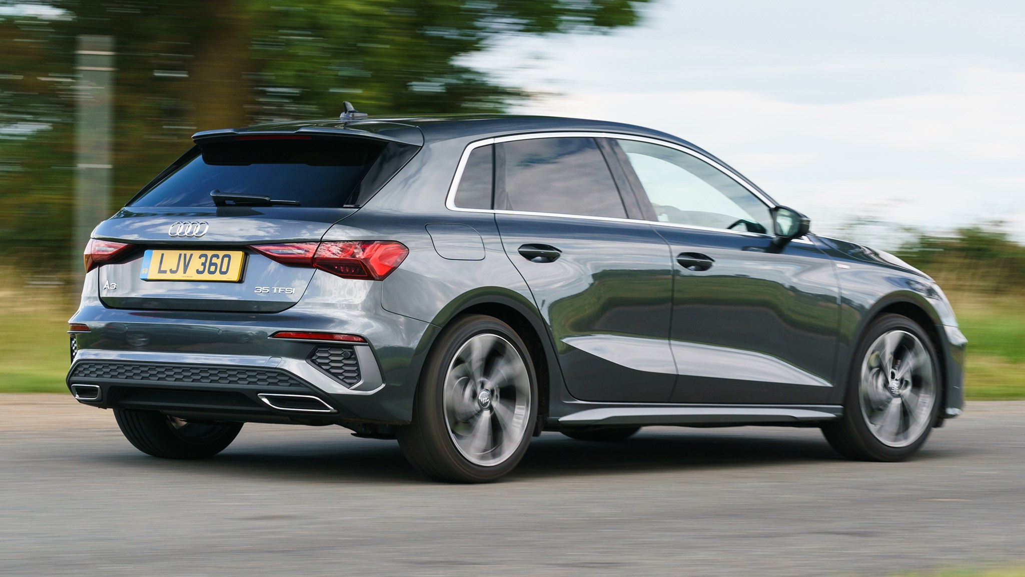 Audi A3 Sportback (2020) rear view, cornering