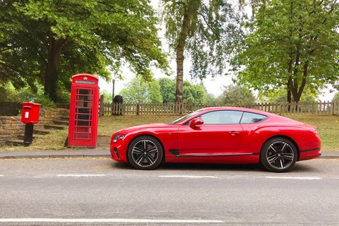 Pillar-box red Bentley meet Royal Mail box and timeless British telephone kiosk