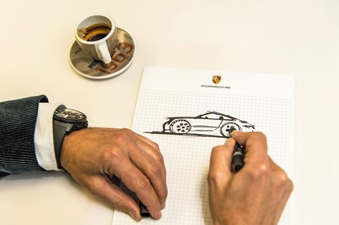 Sketching the purest kind of Porsche: design chief Michael Mauer draws the classic 911 silhouette on notepaper
