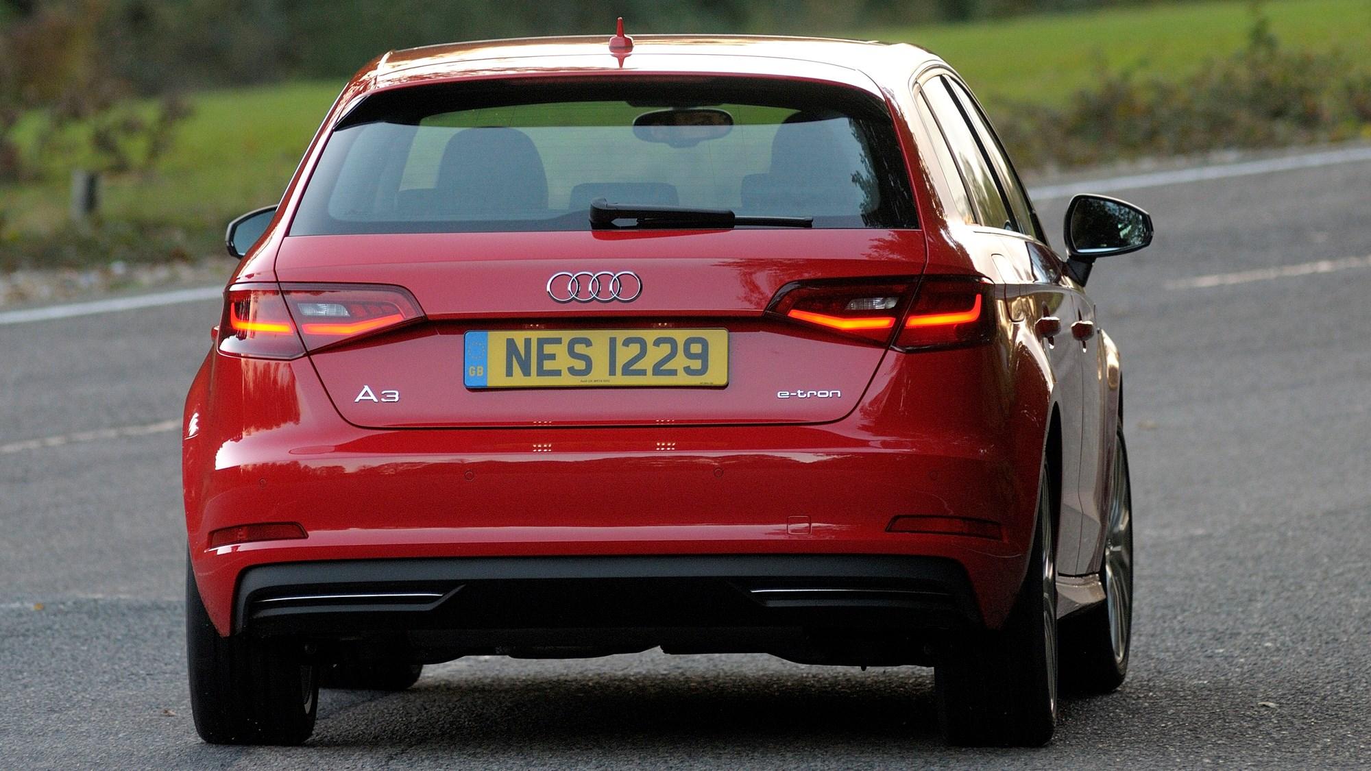 Red 2014 Audi A3 Sportback e-Tron rear three-quarter driving