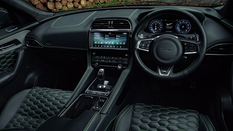 Lister Stealth - interior showing dashboard, black leather with green stitching