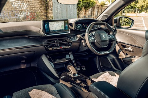 Peugeot e-208 interior: titchy-tiny steering wheel follows the brand's i-Cockpit layout, but it all works well