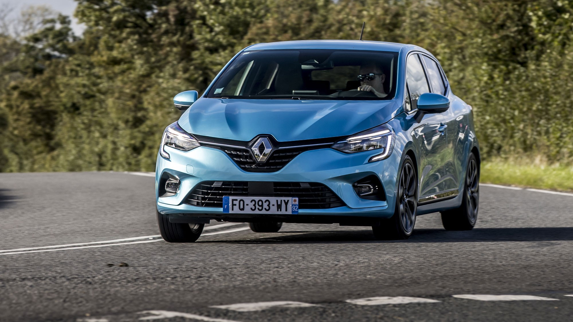 Renault Clio E-Tech hybrid review, 2020, front view, blue, driving round corner