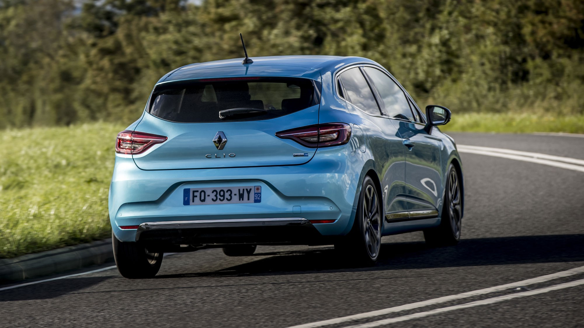 Renault Clio E-Tech hybrid review, 2020, rear view, blue, driving round corner