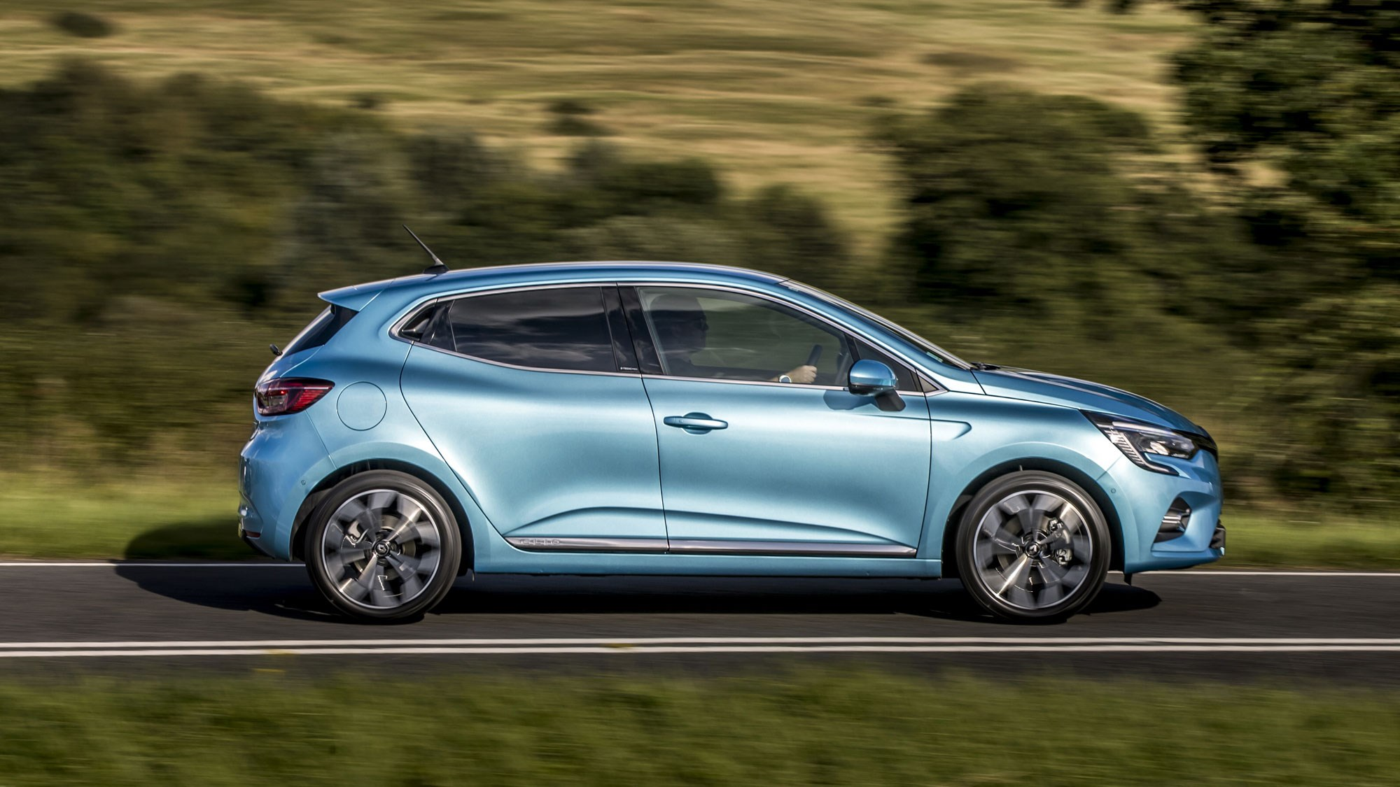 Renault Clio E-Tech hybrid review, 2020, side view, blue, driving