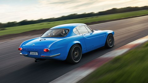 Volvo P1800 Cyan, rear view, driving on circuit