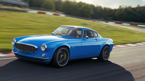 Volvo P1800 Cyan, front view, driving on circuit