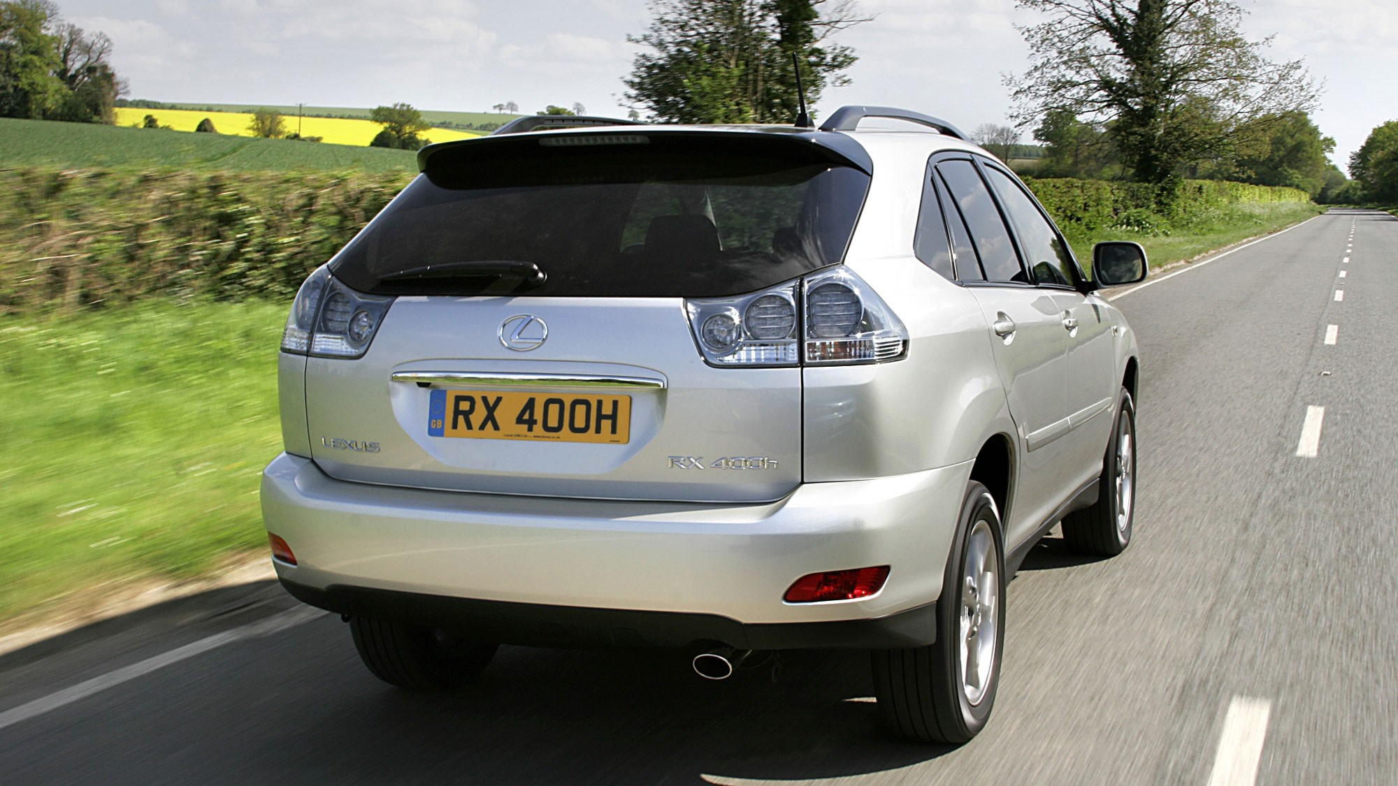 Lexus RX400h hybrid SUV review - rear view, silver, driving