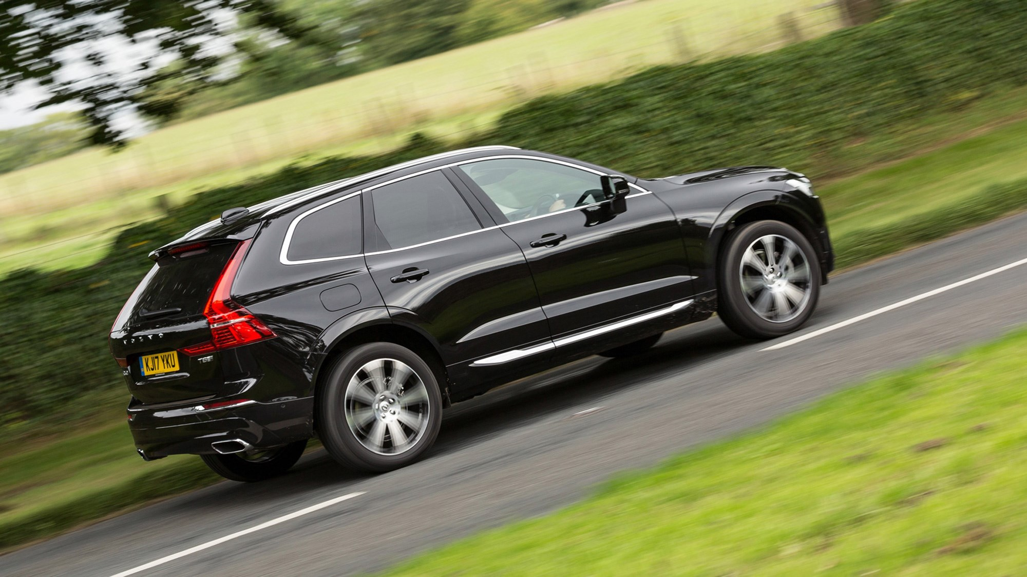 Volvo XC60 hybrid review - T8 Twin Engine plug-in driven, side view, black, driving, 2020
