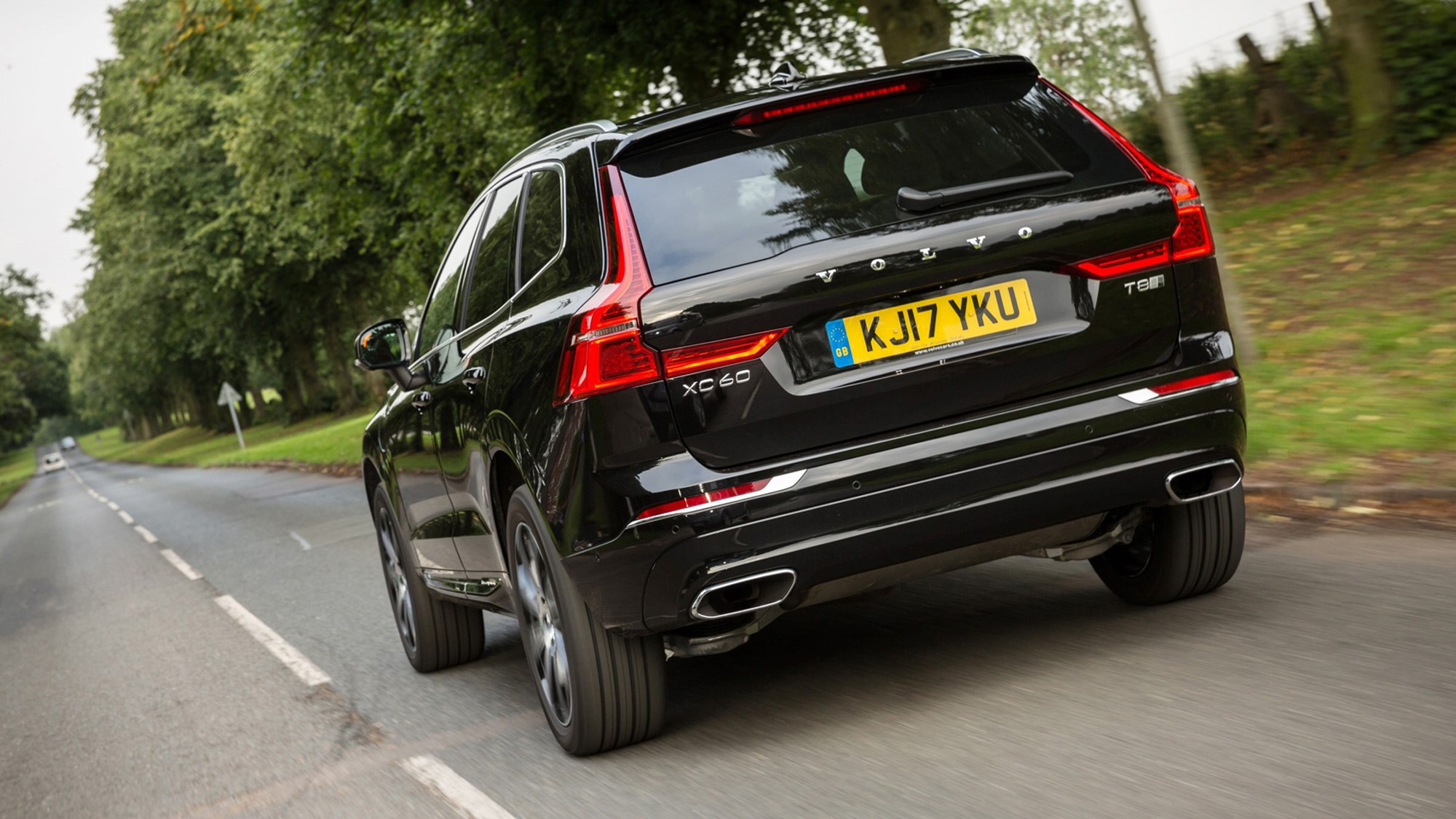 Volvo XC60 hybrid review - T8 Twin Engine plug-in driven, rear view, black, driving, 2020