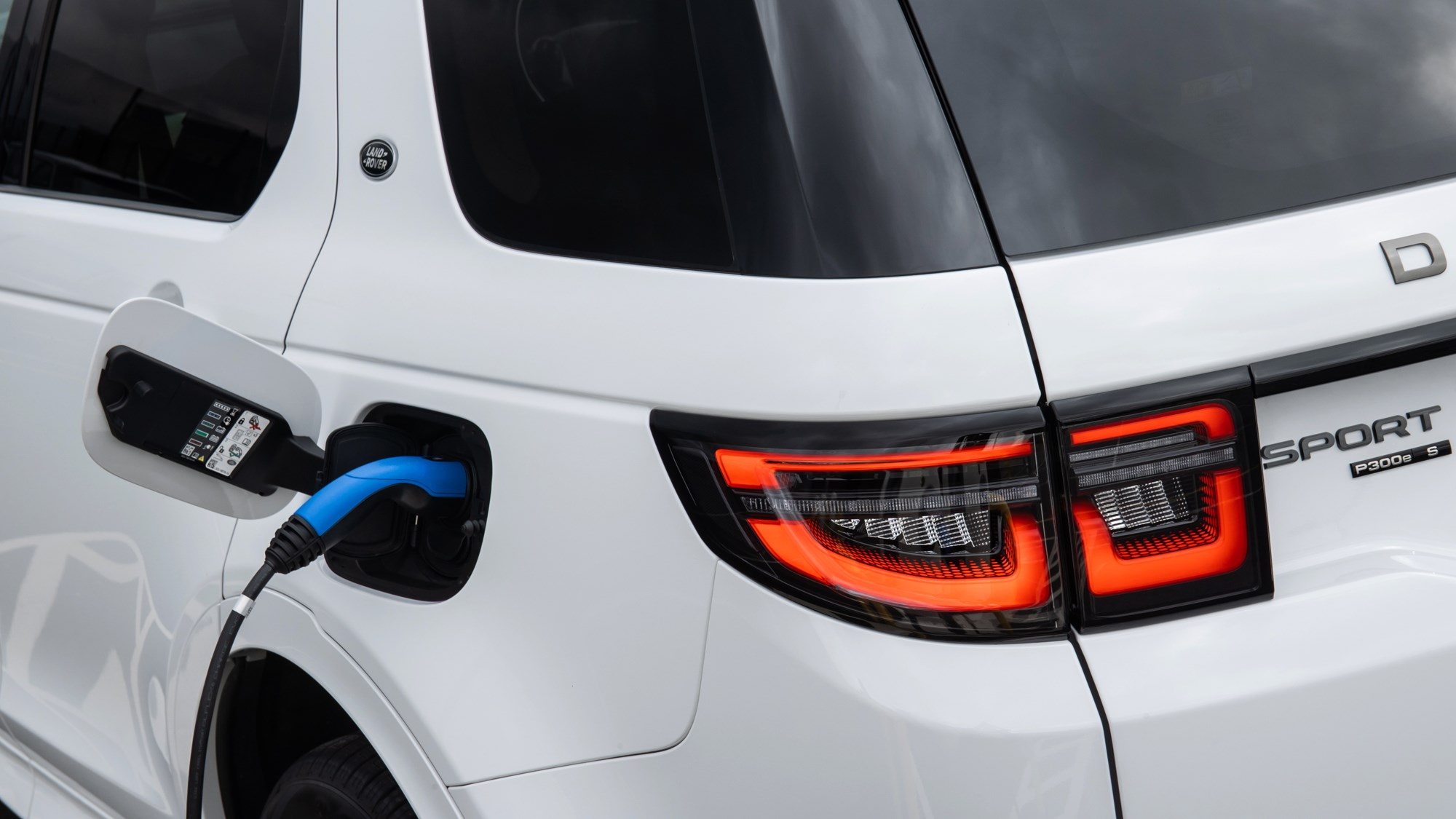 White Land Rover Discovery Sport P300e on charge