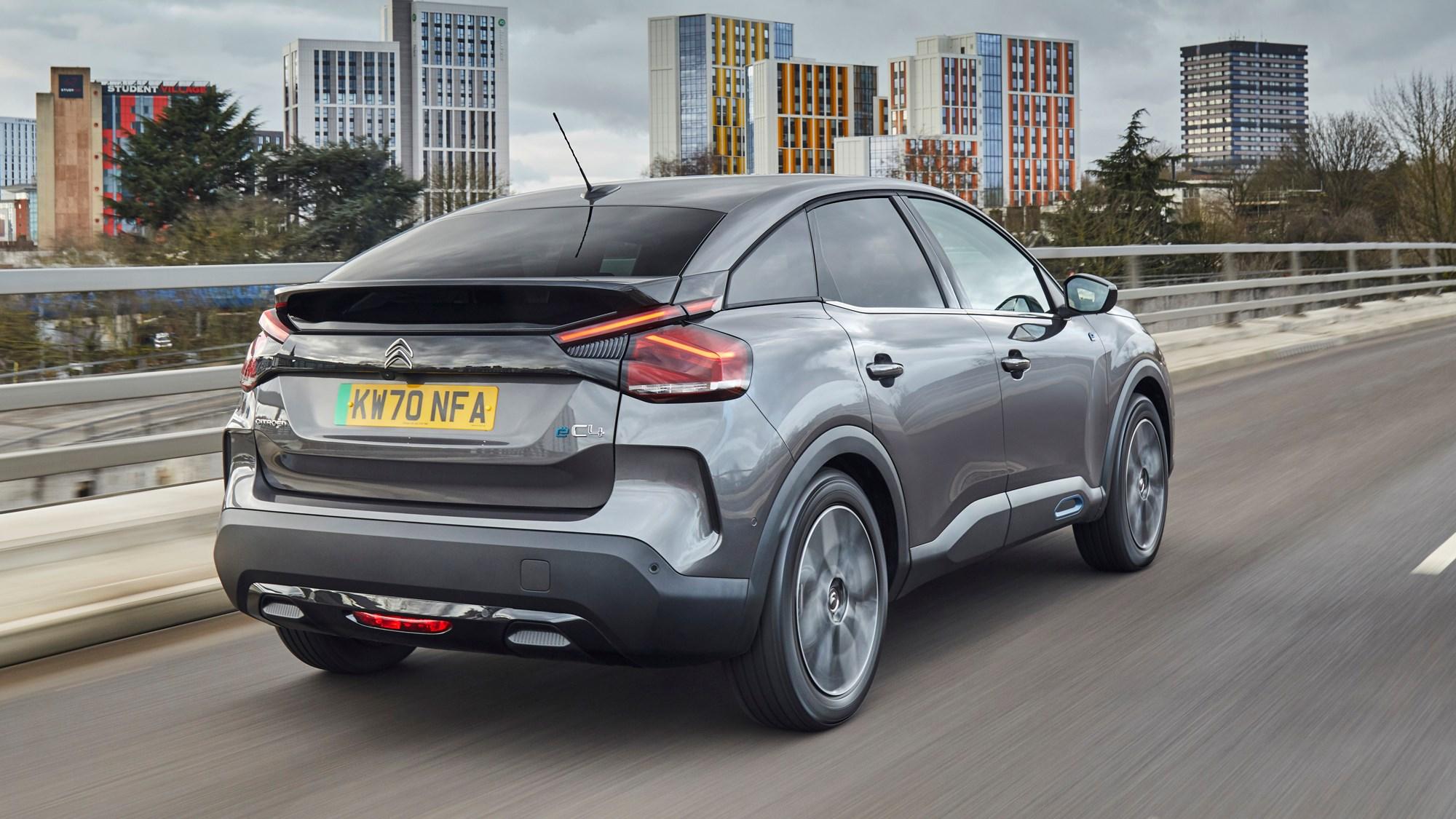 Grey 2021 Citroen e-C4 rear three-quarter driving