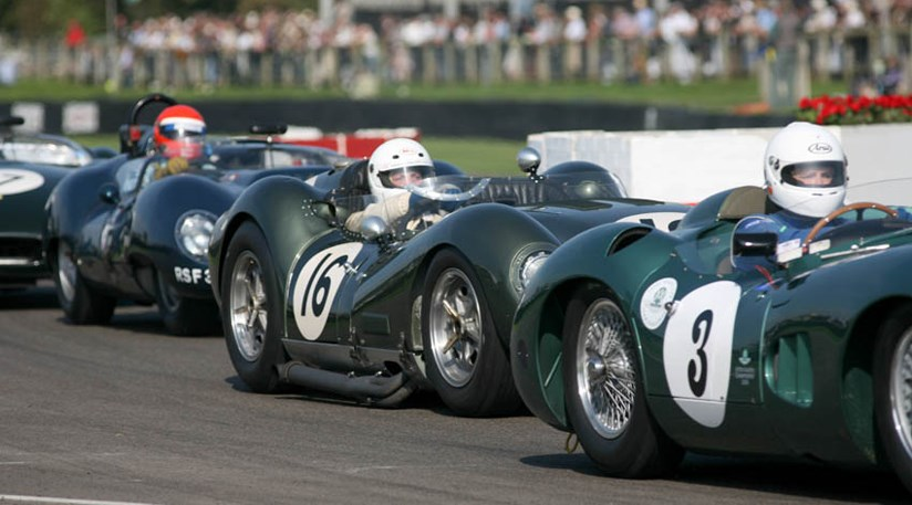 Jamie McIntyre in a sandwich at the chicane between back marker Aston DBR1 and hot pursuer Mark Hales in the Lister Jagaur Costin