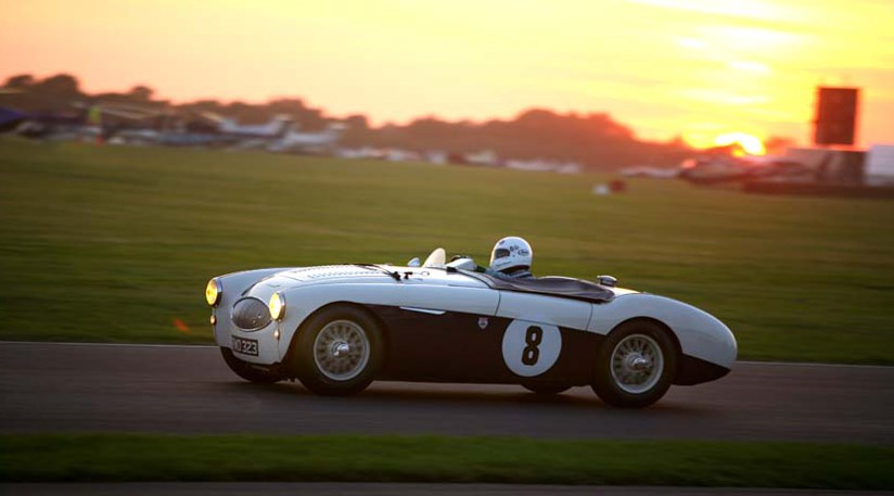 Emanuele Pirro drives the Austin Healey 100S to victory in a race that ran on into the evening