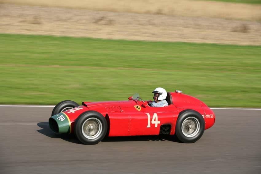 Jochen Mass powers the Lancia Ferrari D50A through into Lavant corner